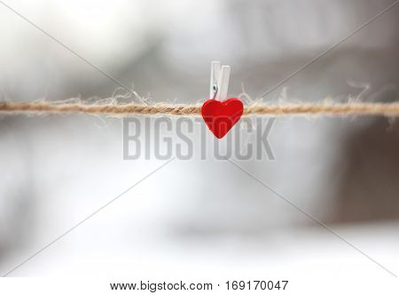 Rope With Red Valentine's Pinned Heart. Valentine's Day Background