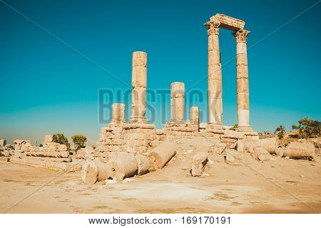Photo of the Hercules Temple remains on Amman Citadel hill, Jordan. Ancient ruins. Travel concept. Tourist attraction. Sightseeing tour. Famous historical monument. Copy space.