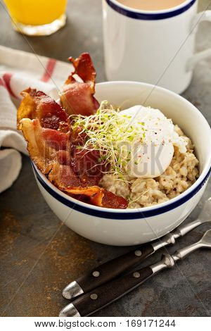 Savory oatmeal porridge with poached egg and bacon