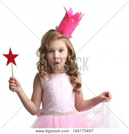 Little fairy girl in pink dress and crown with magic wand isolated on white background