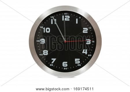 Generic black and silver wall clock showing at the eleventh hour on a white background