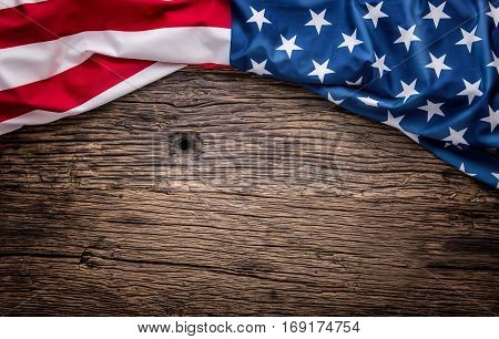 USA flag. American flag. American flag freely lying on wooden board. Close-up Studio shot. Toned Photo.