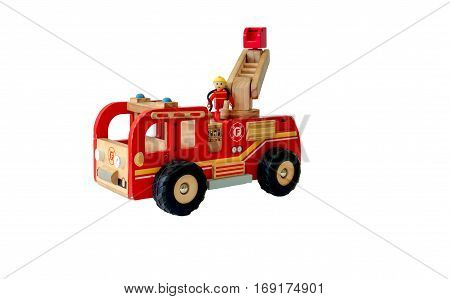 Vintage wooden red fire truck toy isolated