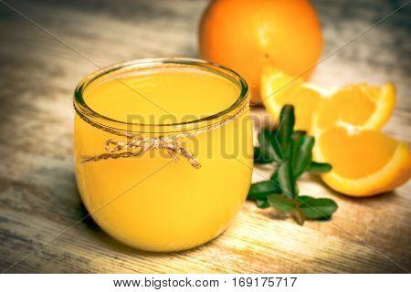 Orange juice on rustic table - freshly squeezed orange juice