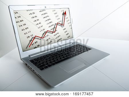 notebook keyboard and graphics and digits on a grey background