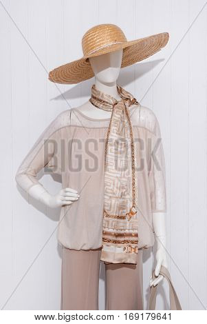 female clothing with hat and scarf,bag  on mannequin