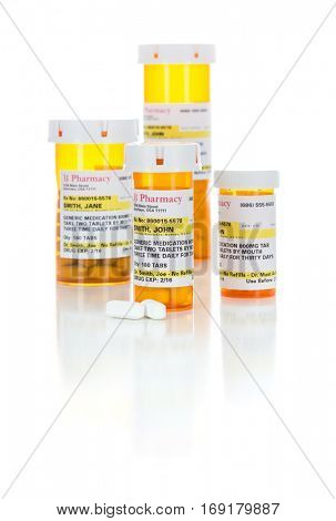 Non-Proprietary Medicine Prescription Bottles and Pills Isolated on a White Background. These labels contains only fictitious information.