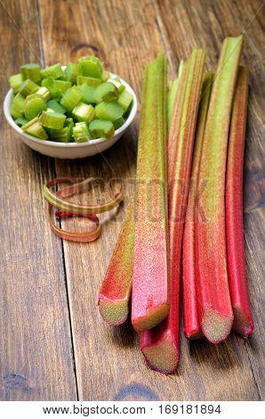 Fresh rhubarb on wooden table, vegetarian food
