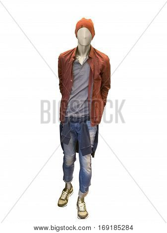 Full-length male mannequin dressed in red jacket and blue jeans. Isolated on white background. No brand names or copyright objects.