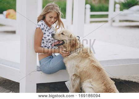 girl walking in the park with his dog girl playing with a dog at the beach and in the park