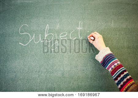 Handwritten message on a chalkboard at school: subject