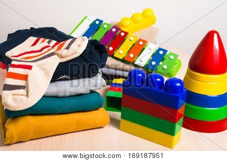 Kids clothes and different toys for education
