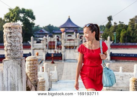 Asian caucasian young woman visiting the circular mound altar, part of the temple of heaven landmark in Beijing, China. Famous tourist attraction in Asia. Summer travel.
