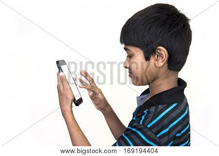 an handsome kid addicted to his mobie phone