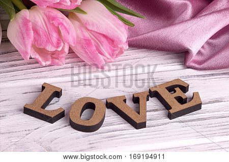 Valentine's Day Elegant Still Life With Tulip Flowers Pink Fabric And Lettering Love Sign On White W