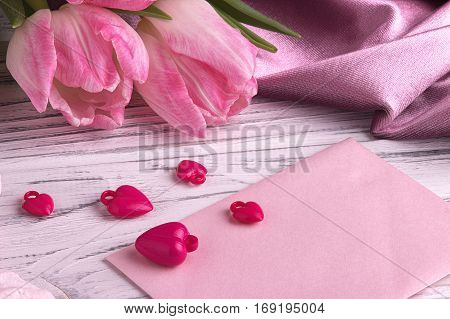 Valentine's Day Background With Pink Tulip Flowers Red Hearts Shape Sign On White Pink Envelope On W