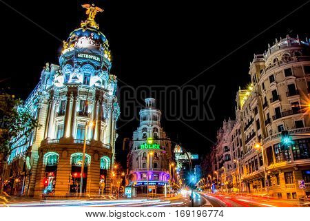Madrid, Spain - June 3, 2013: Night view of the street Grand Via and Metropolis hotel  building in Madrid
