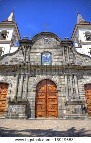 Old colonial church facade, on a sunny day in Ibarra, Ecuador.