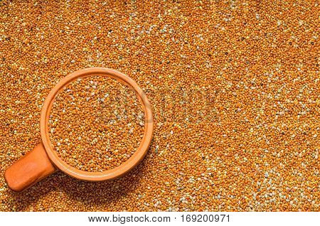 Background from untreated millet seed scattered on the surface and filled the Cup. Selective focus