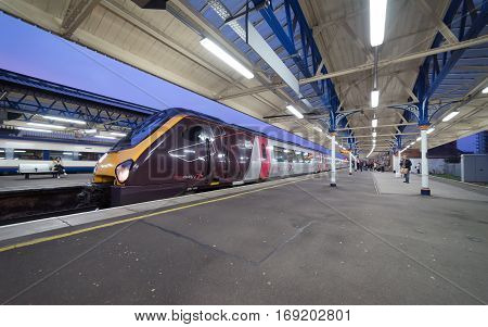 Basingstoke, UK. 5th February 2017. A Crosscountry service waits on a platform at Basingstoke station awaiting departure to the south coast of England. People are waiting on the platform.