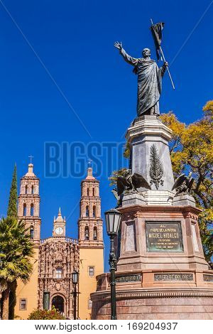 DOLORES HIDALGO, MEXICO - DECEMBER 29, 2014 Father Miguel Hidalgo Statue Parroquia Cathedral Dolores Hidalgo Mexico. Where Father Miguel Hidalgo made his Grito de Dolers starting the 1810 War of Independence in Mexico. Statue erected 1867.