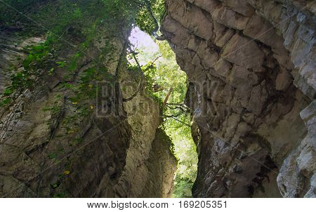 hidden white rocky gorge in the view of the valley below with a narrow rock corridor meshed walls