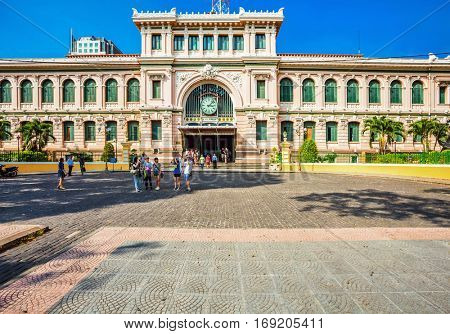 HO CHI MINH, VIETNAM - APRIL 28, 2014: Customers and tourists near General Post Office. It was built by the French in 1880s and is now a popular tourist attraction in Ho Chi Minh city