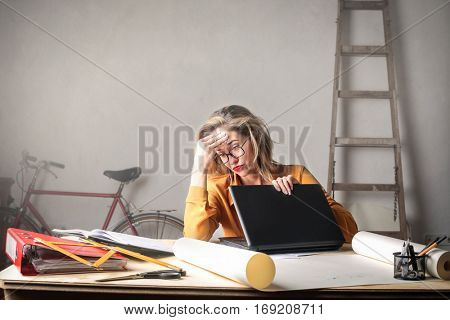 Blonde woman got tired of working