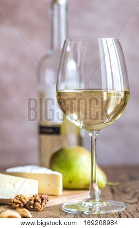 Glass Of White Wine With Cheese And Nuts