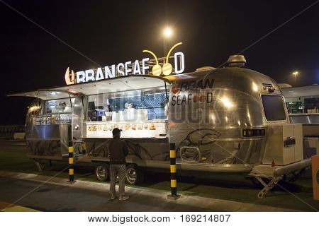 DUBAI UAE - DEC 4 2016: Airstream caravan food truck Urban Seafood at the Last Exit food trucks park on the E11 highway between Abu Dhabi and Dubai