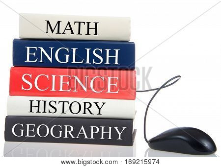 Online education. Core course subjects written on book binding with computer mouse coming out of the books. internet concept moving from hard copy books to online