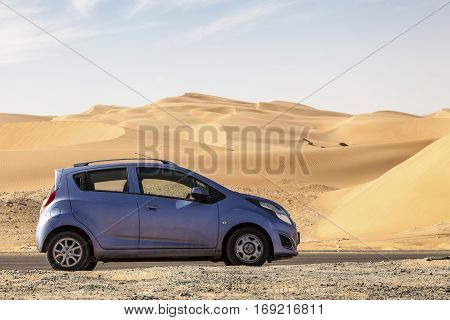 MADINAT ZAYED, UAE - DEC 4, 2016: Small rental car in a desert road to the Moreeb Dune in Liwa Oasis area. Emirate of Abu Dhabi United Arab Emirates