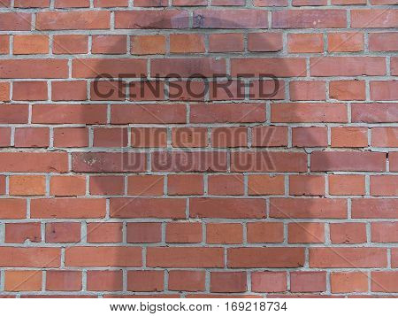 Word Censored On Transparent Head Silhouette On Red Brick Wall illustration