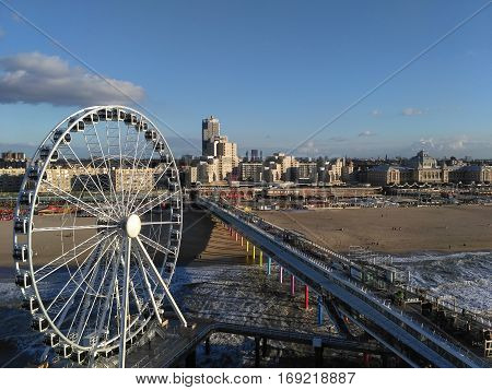 Ferris wheel at beach of The Hague , Netherlands .