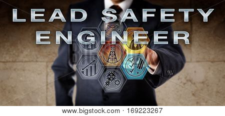 Recruitment manager in blue business suit pushing LEAD SAFETY ENGINEER on an interactive remote control screen. Oil and gas industry job concept for an engineering position overseeing compliance.
