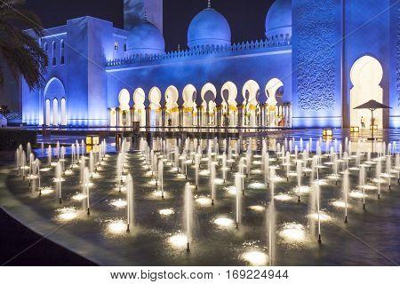 ABU DHABI, UAE - DEC 4, 2016: Sheikh Zayed Grand Mosque illuminated at night. Abu Dhabi United Arab Emirates Middle East