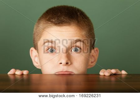 Young Boy Peeping Out The Table