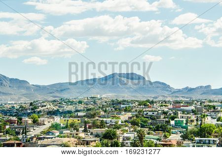 Ciudad Juárez in Mexico cityscape or skyline viewed from border with El Paso Texas
