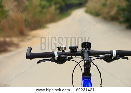 closeup of riding mountain bike on forest trail