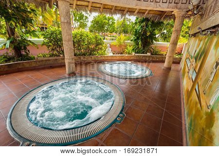 Holguin Province, Playa Pesquero hotel, Cuba, Sep. 4, 2016, gorgeous amazing inviting view of outdoor spa room with hydro massage working jacuzzi