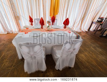 amazing beautiful inviting view of birthday decorated table in old fashioned vintage restaurant, ready to serve their guests
