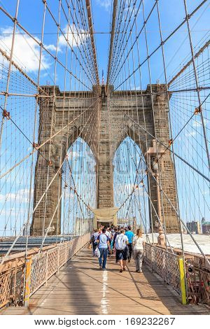 New York USA- May 21 2014. Traveling people at Brooklyn bridge the famous and landmark place in New York City on clear sunny day.