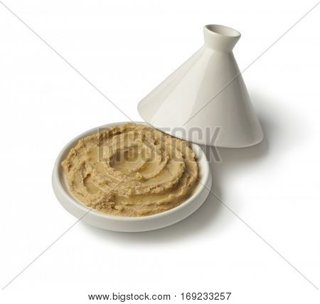 Tagine with Moroccan hummus and olive oil on white background