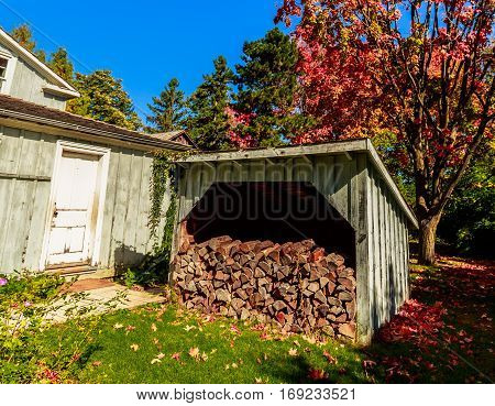 gorgeous beautiful view of outdoor wooden shed with fire woods inside, prepared for house heating at winter time