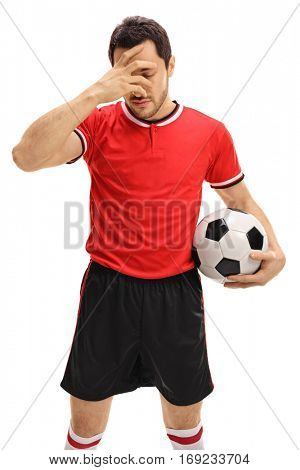 Sad football player holding his head in disbelief isolated on white background
