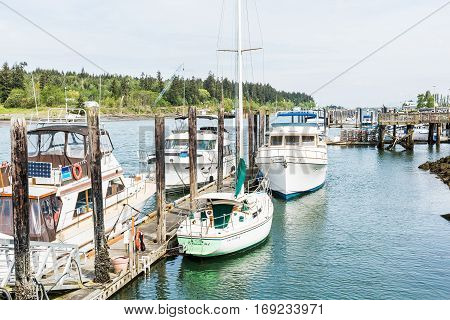 La Conner, USA - April 21, 2016: Boats and waterfront waterway bay Swinomish channel in historical village in Washington State