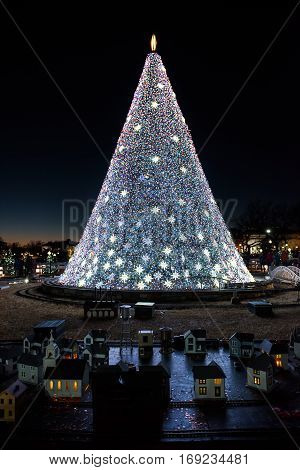 Washington DC, USA - December 29, 2016: National Mall Christmas tree with visitors illuminated with toy trains and houses