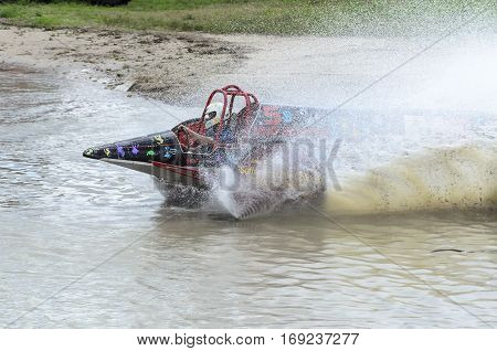 Naples Florida USA - March 3 2012: Swamp buggy spins up sheet of muddy water