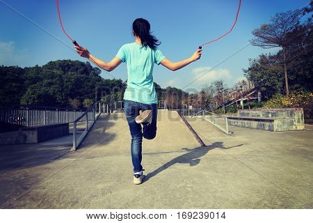 closeup of one young woman jumping rope