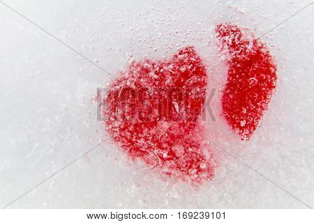 Broken red heart frozen in ice for Valentine's Day